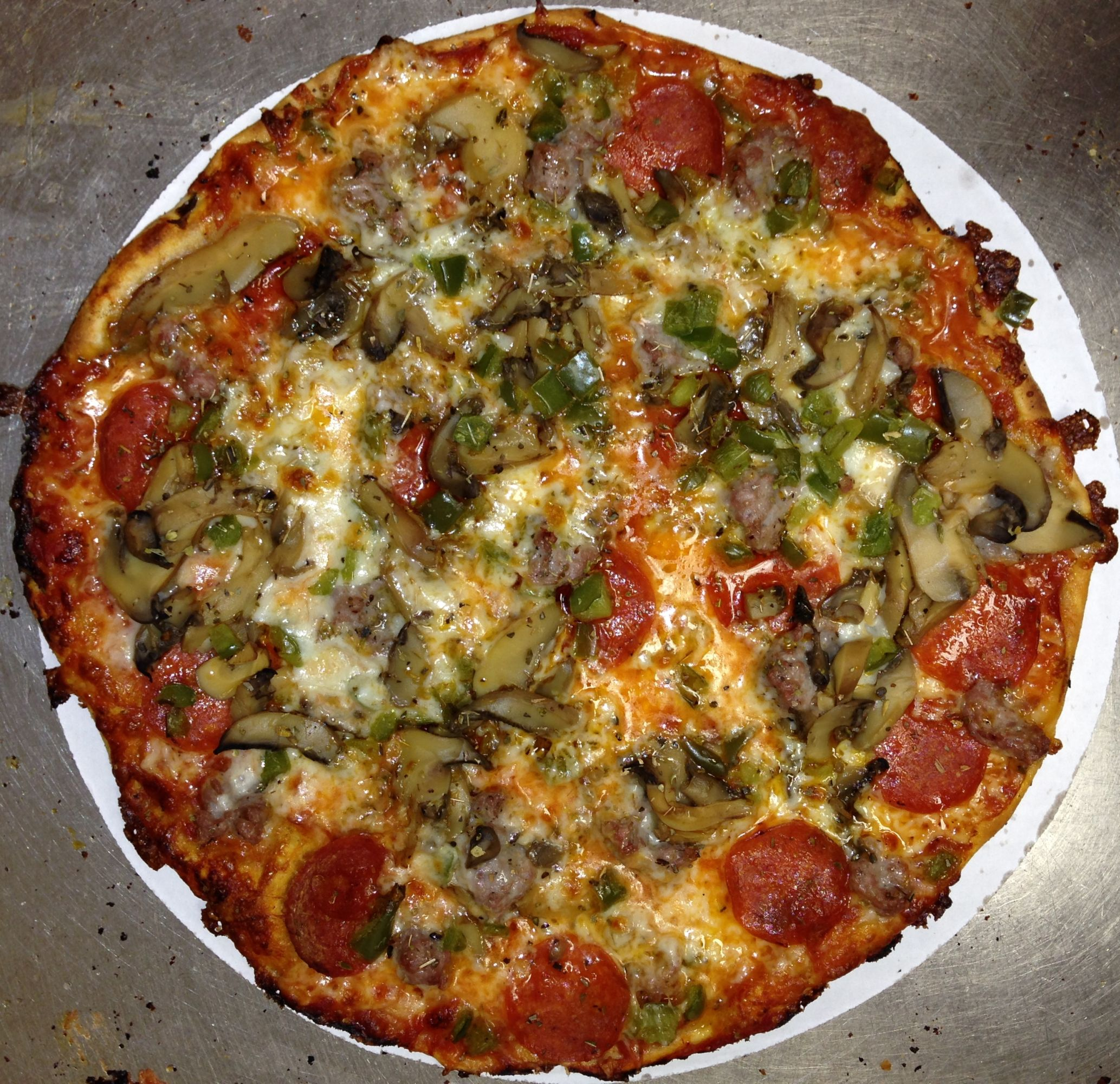 Fricanos EBA Everything But Anchovies, Pepperoni, Italian Sausage, Mushroom & Green Pepper Pizza Pie.jpg