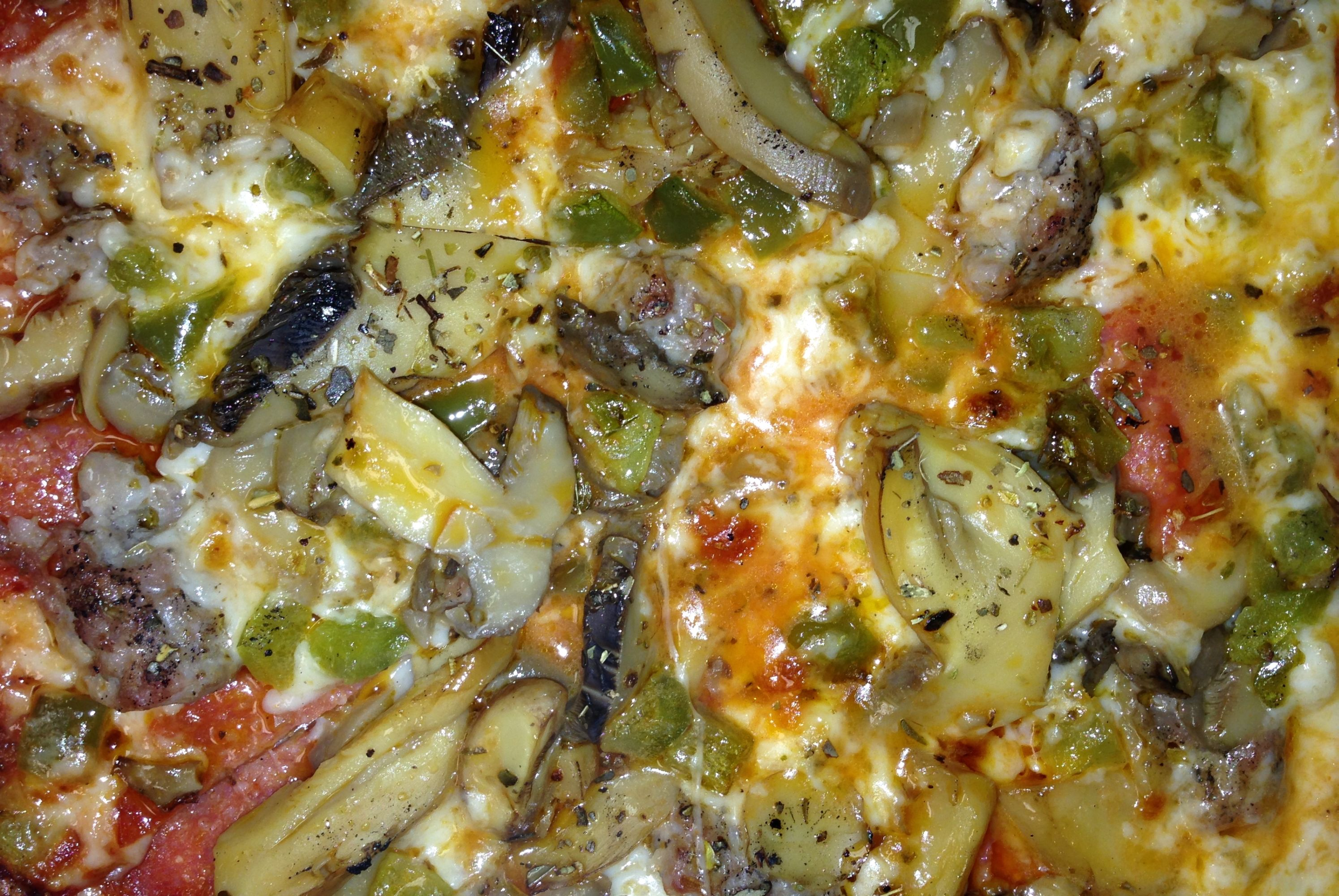 Fricanos_Zoomed in EBA Pepperoni, Sausage, Mushroom, Green Pepper Pizza.jpg