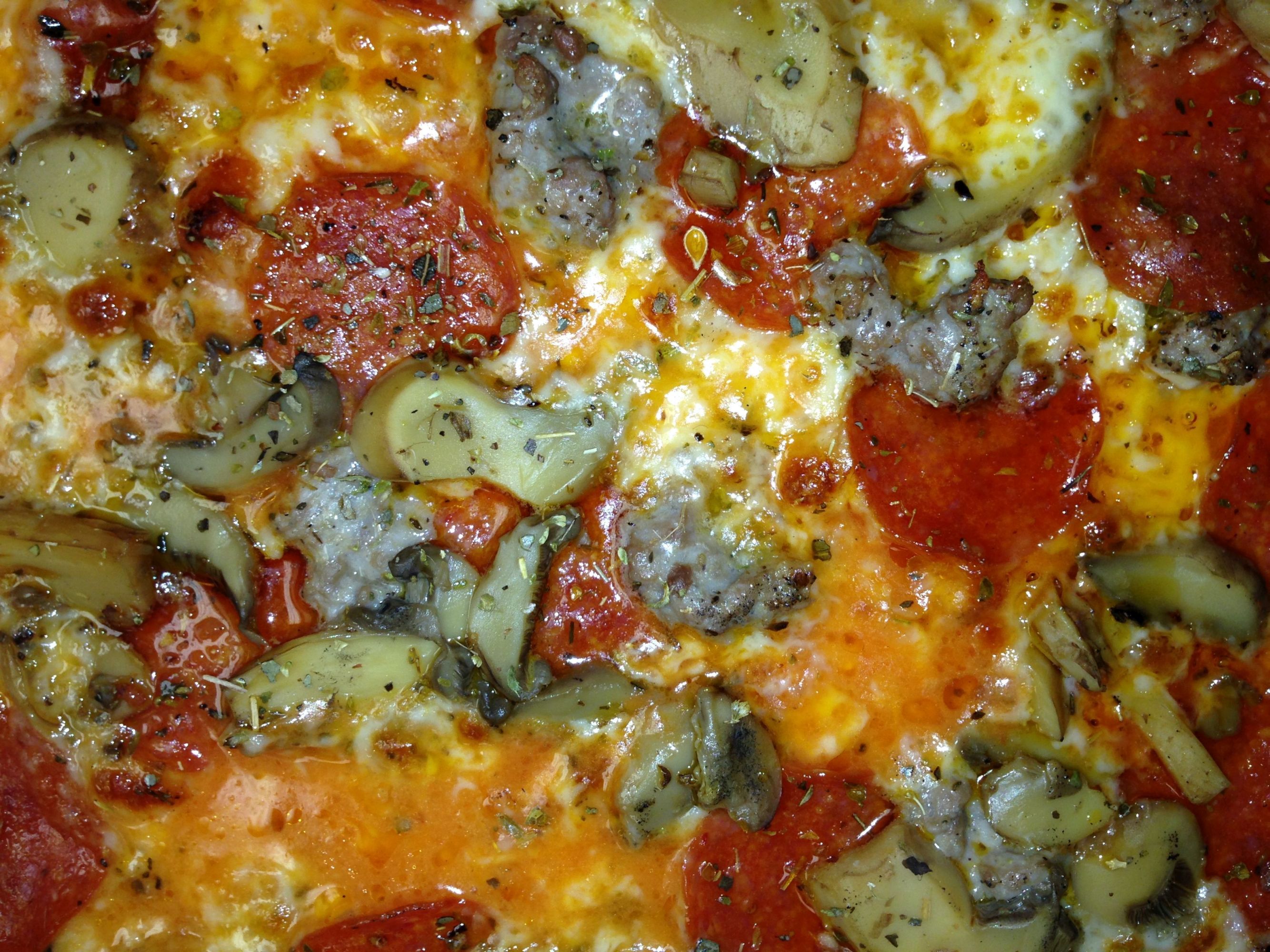 Fricanos_Zoomed in Pepperoni, Sausage, Mushroom Pizza.JPG